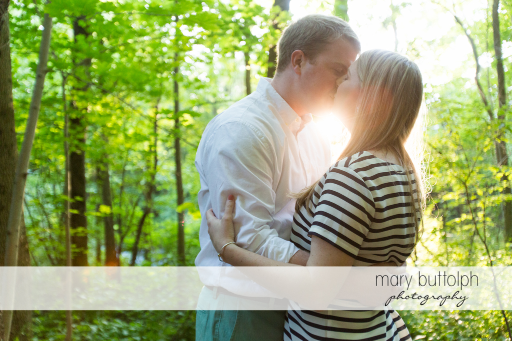 Couple catch the sunset in the woods at Skaneateles Engagement
