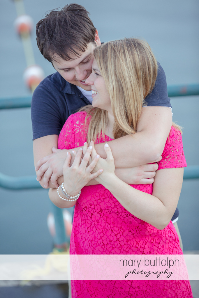 Couple share a tender moment at Green Lakes State Park Engagement