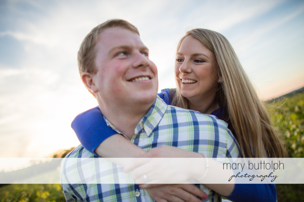 Couple enjoy their time together in the field at Skaneateles Engagement