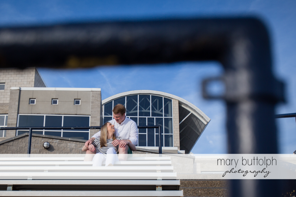 Couple enjoy the view at the stadium at Skaneateles Engagement