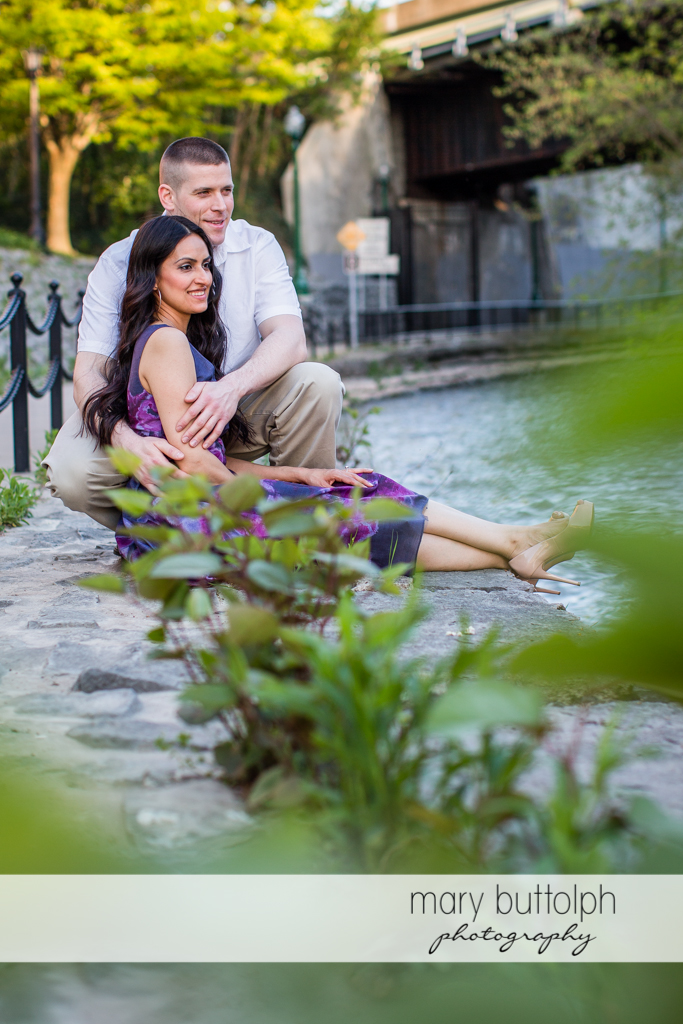 Couple relax near the lake at Franklin Square Engagement