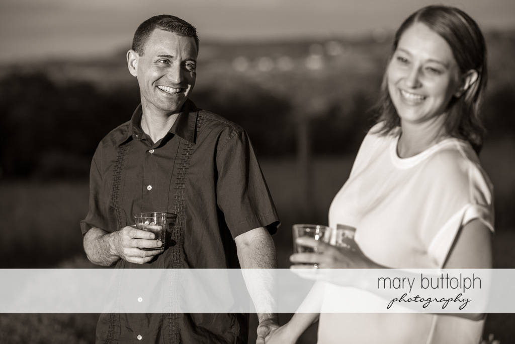 Couple have a drink in the field at Lockwood Lavender Farm Engagement