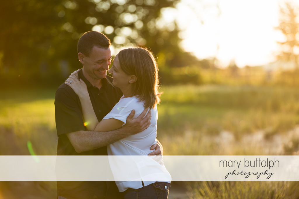 Couple share a happy moment in the field at Lockwood Lavender Farm Engagement