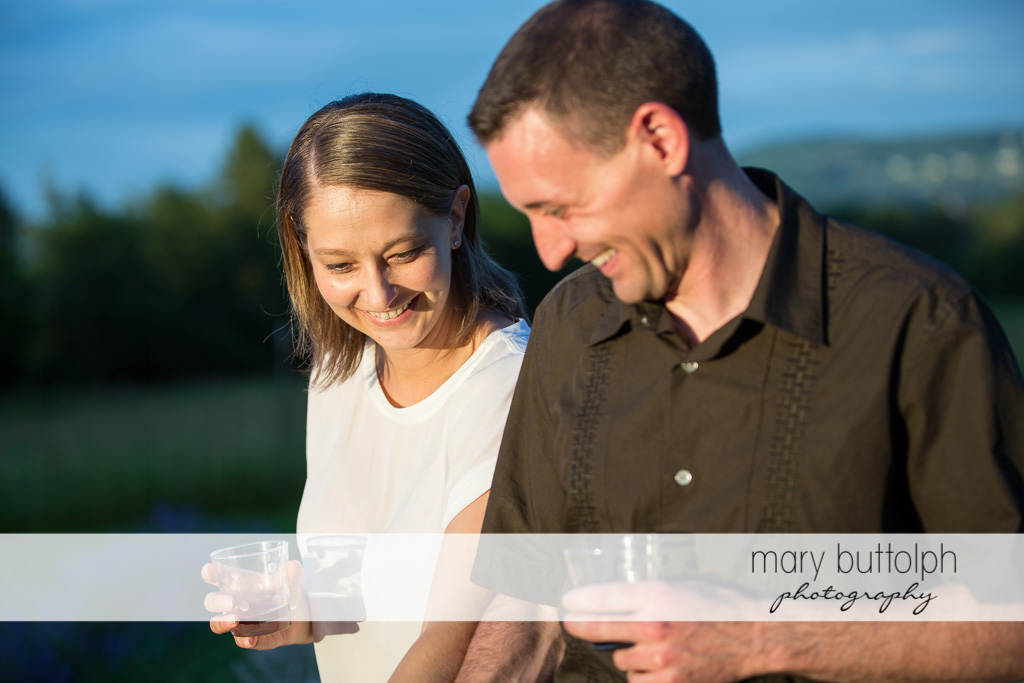 Couple share a laugh in the field at Lockwood Lavender Farm Engagement