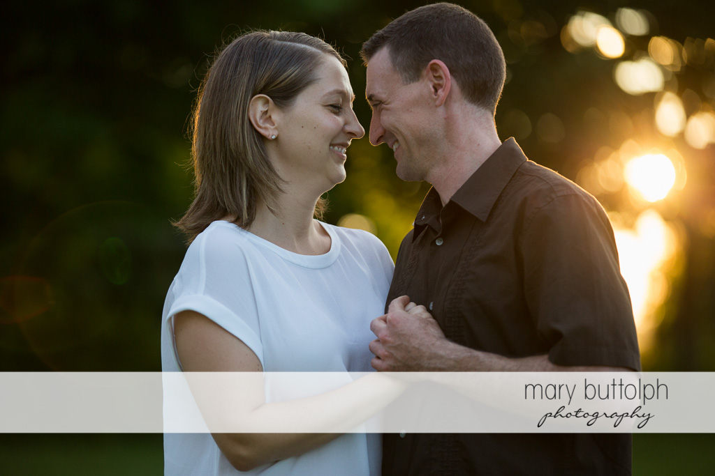 Couple face each other at Lockwood Lavender Farm Engagement
