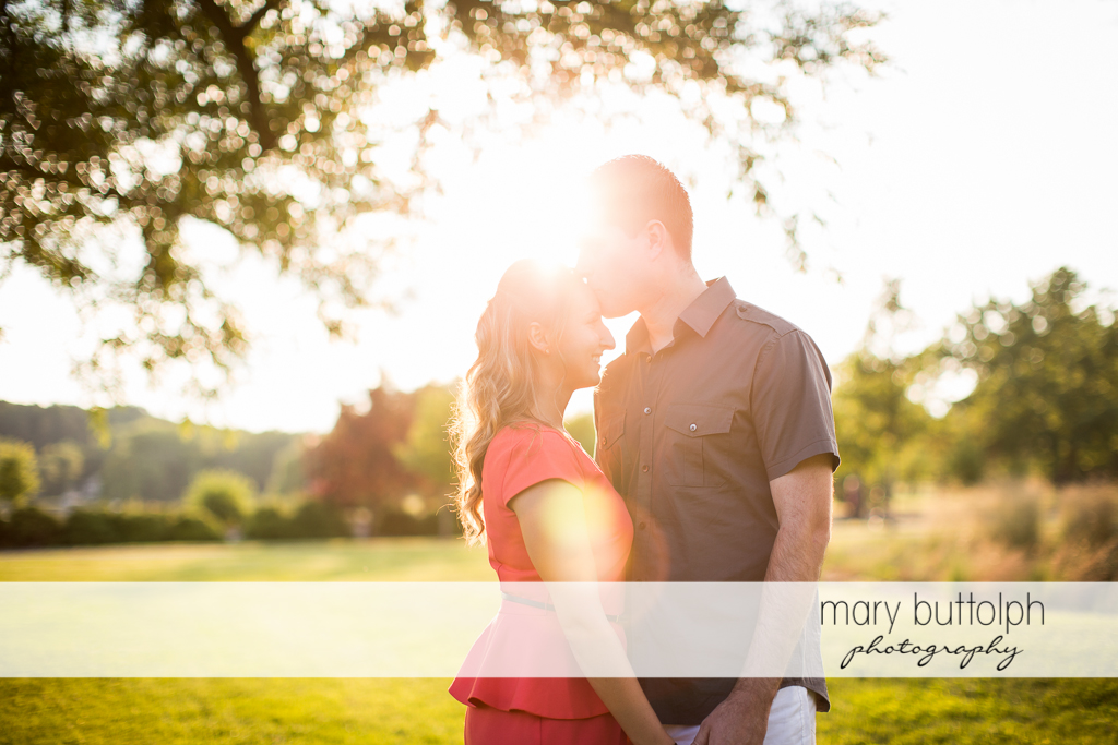 Couple catch the sun's rays in the garden at Emerson Park Engagement