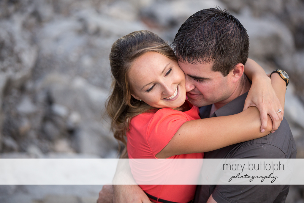 Couple embrace in the garden at Emerson Park Engagement