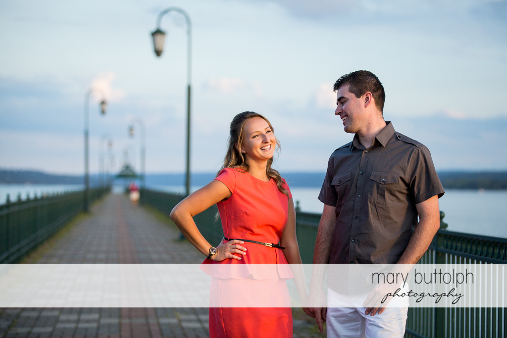 Couple pose by the river at Emerson Park Engagement