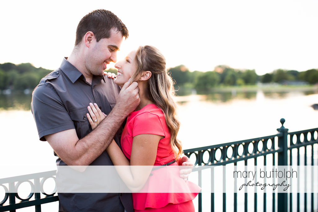 Couple show their affection by the river at Emerson Park Engagement