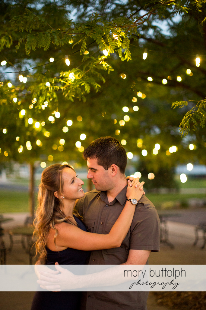 Couple spend time under the tree lights at Emerson Park Engagement
