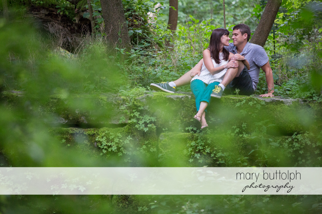 Couple relax in the woods at Skaneateles Lodge at Welch Allyn Engagement