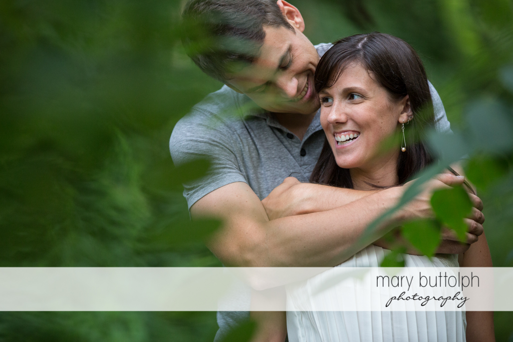 Medium shot of couple in the garden at Skaneateles Lodge at Welch Allyn Engagement