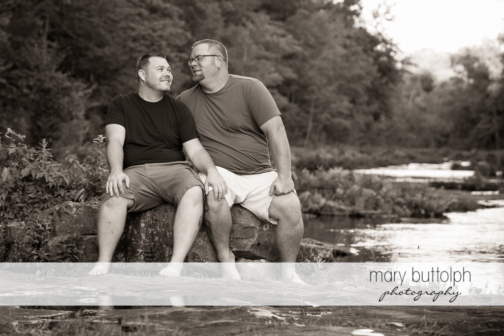 Same sex couple spend a quiet time at the river at Salmon River Falls Engagement