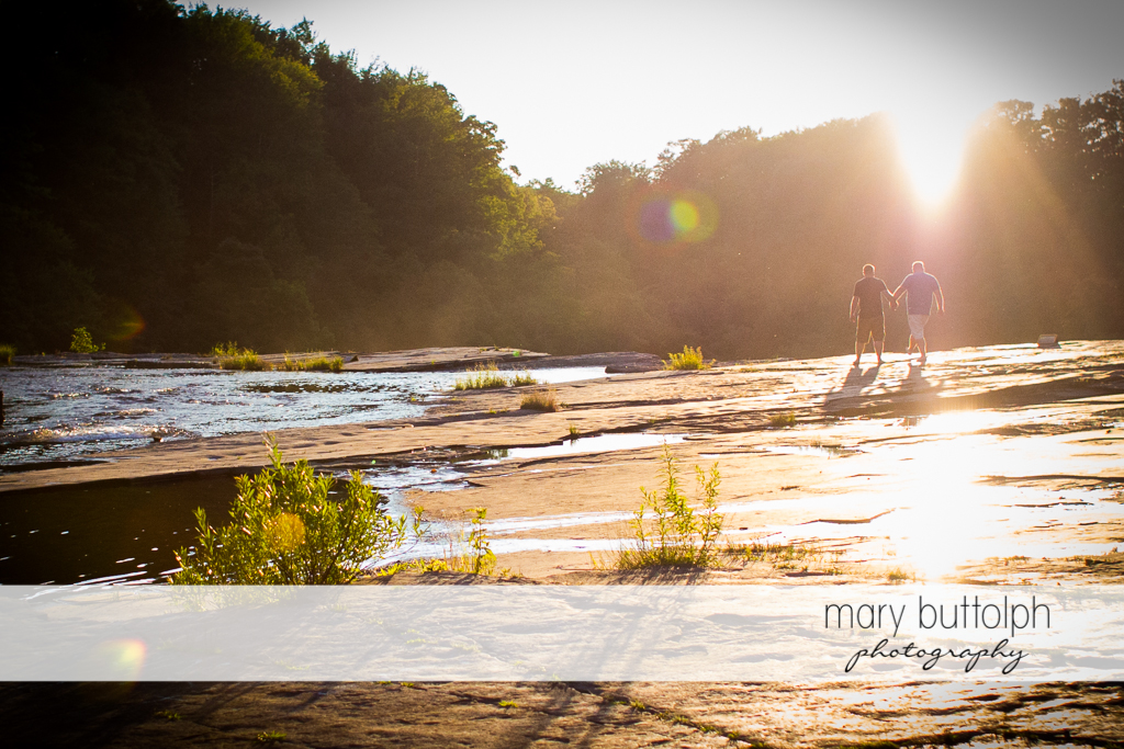 Same sex couple stroll near the river at Salmon River Falls Engagement