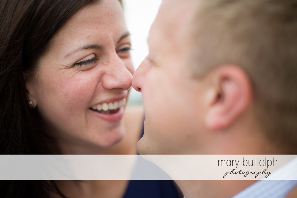 Couple rub noses in this close up shot at Skaneateles Farm Engagement
