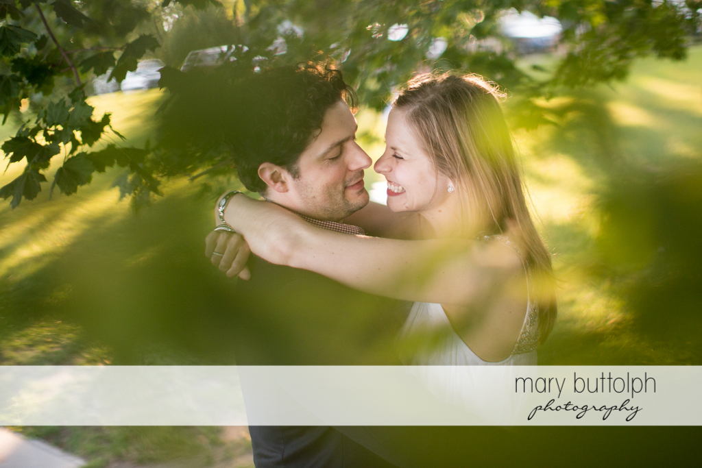 Couple embrace in the garden at Skaneateles Engagement