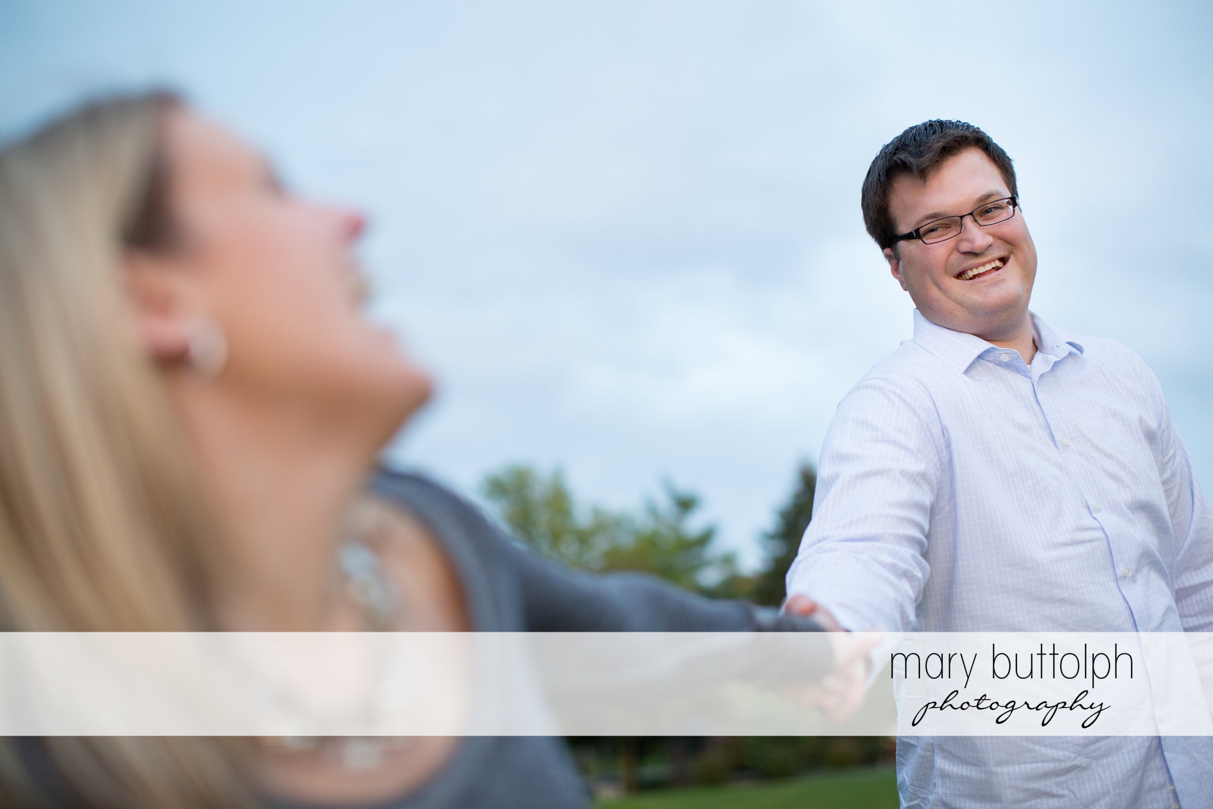 Couple have fun in the garden at SUNY Geneseo Engagement