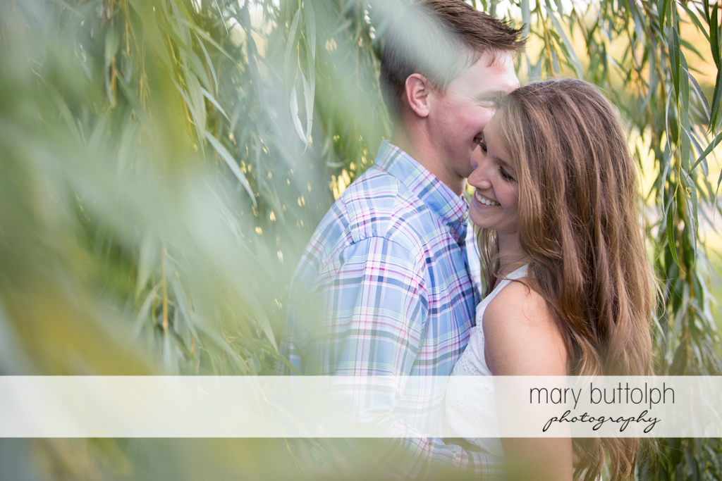 Couple get romantic in the garden at Aurora Engagement