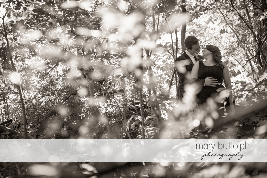 Couple share a quiet moment in the woods at Beaver Lake Nature Center Engagement