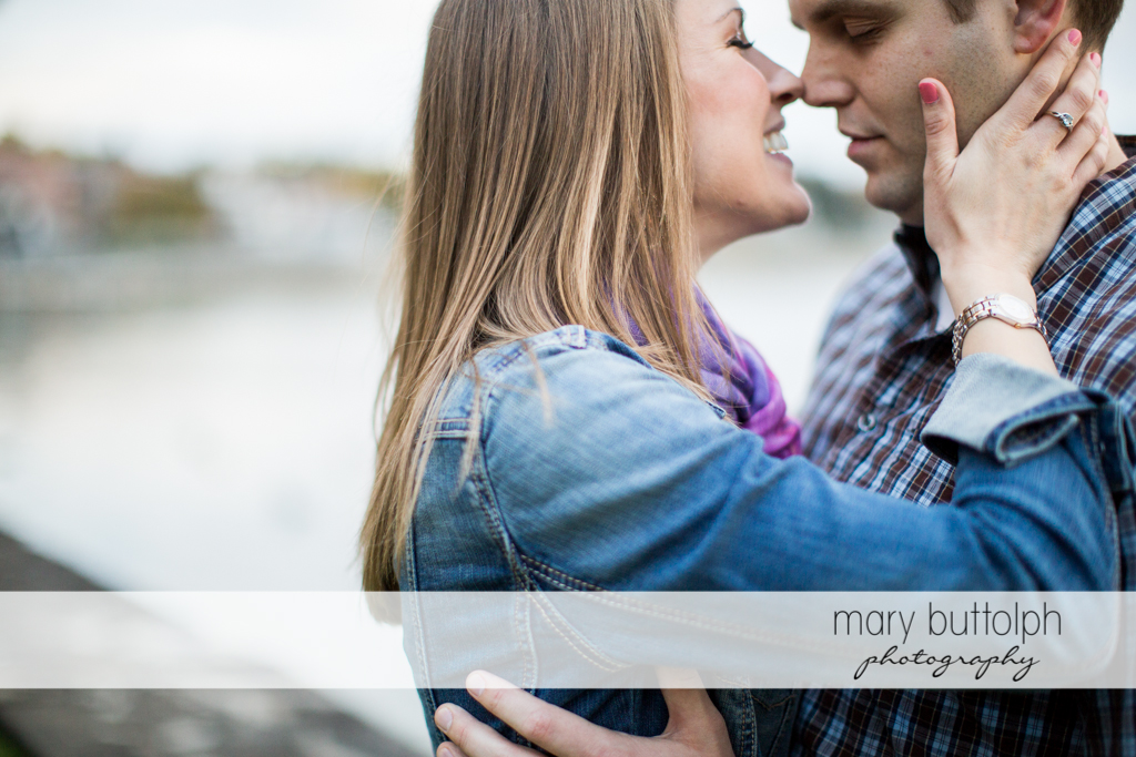 Couple rub noses at Skaneateles Engagement