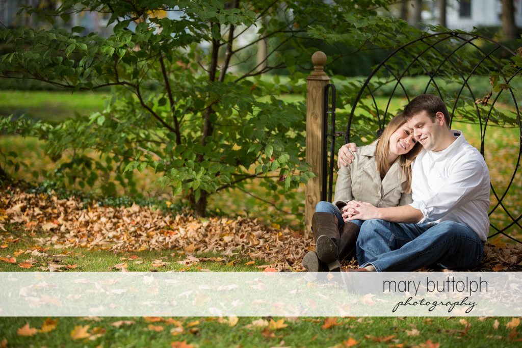 Couple enjoy their time together in the garden at Skaneateles Engagement