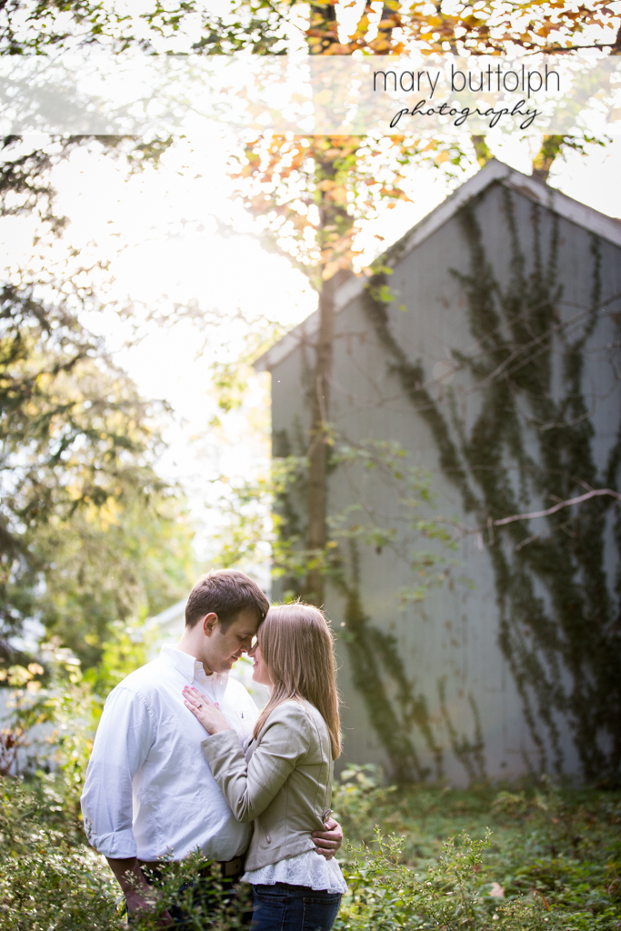 Couple in a romantic mood in the woods at Skaneateles Engagement