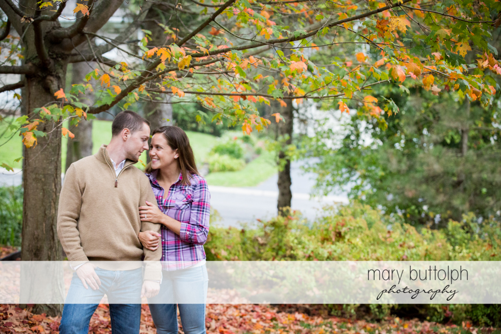 Couple face each other in the garden at Syracuse University Engagement