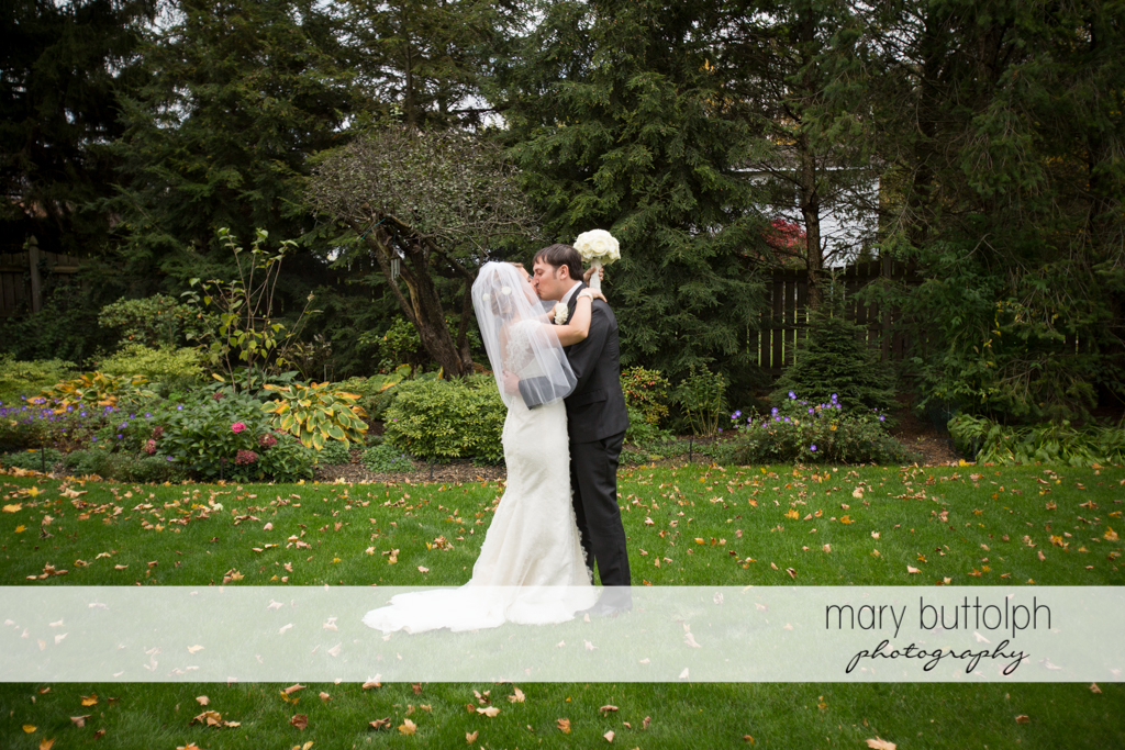 Couple kiss in the garden at Traditions at the Links Wedding