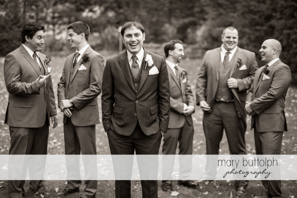 The groom and his groomsmen in the garden at Traditions at the Links Wedding