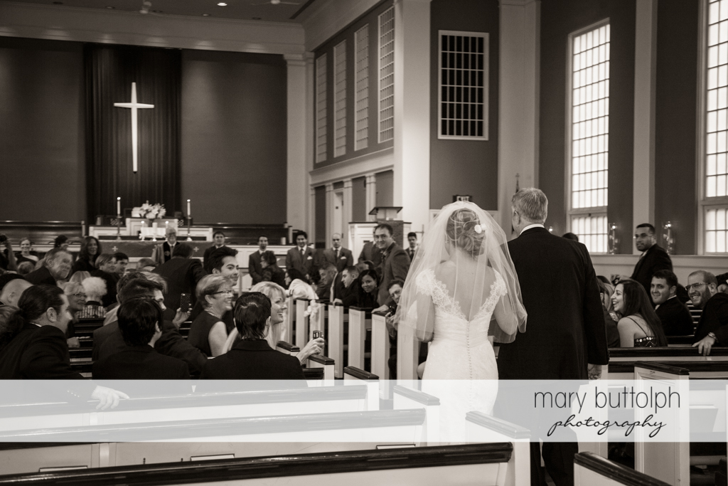 Bride and her father walk down the aisle at Traditions at the Links Wedding