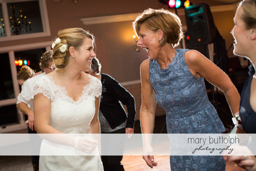 Bride laughs with guest at Traditions at the Links Wedding