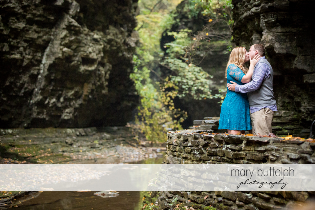 Couple in a romantic mood in the gorge at Watkins Glen Engagement