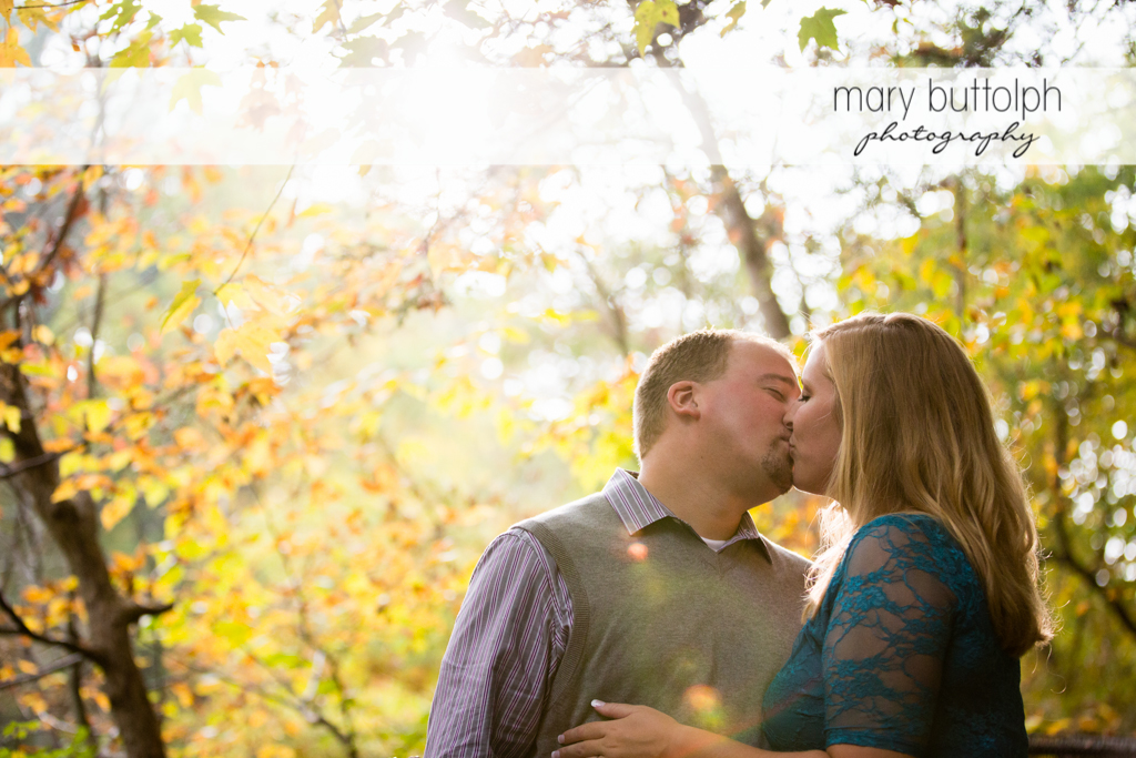 Couple kiss in the woods at Watkins Glen Engagement