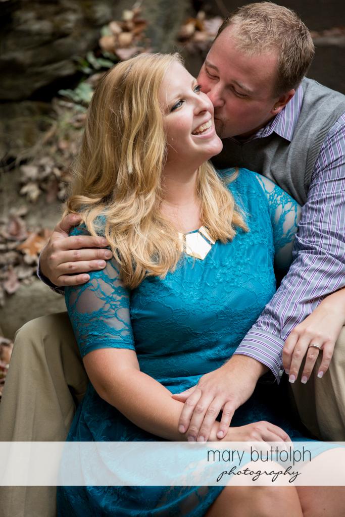 Man kisses the woman at Watkins Glen Engagement