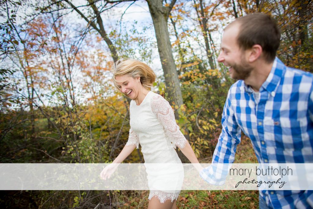 Couple stroll in the garden at Beak & Skiff Apple Orchards Engagement