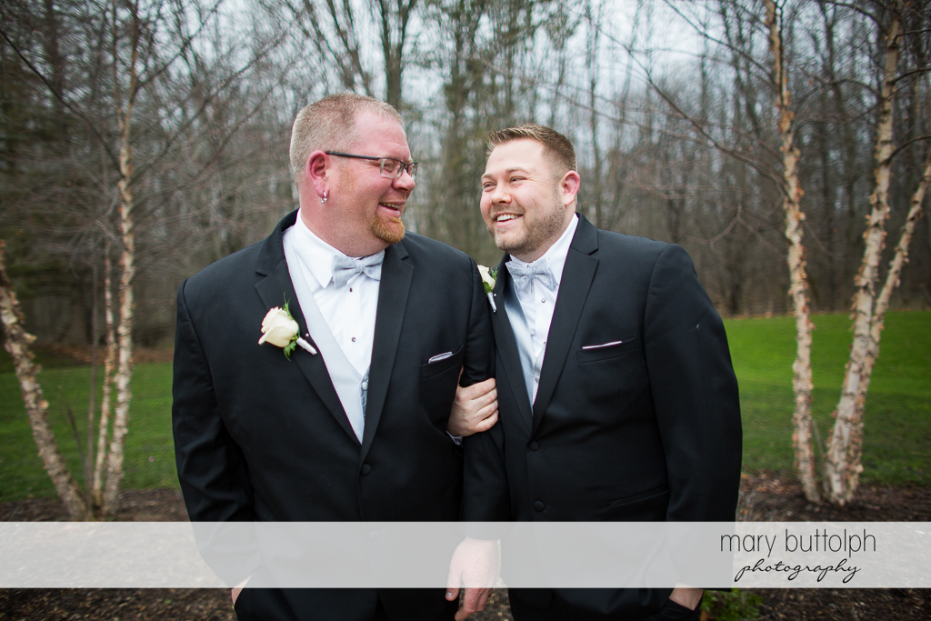 Same sex couple in the woods at Arrowhead Lodge Wedding