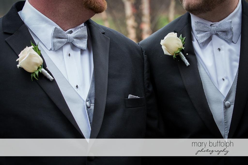 Same sex couple wear identical suits and boutonnieres at Arrowhead Lodge Wedding