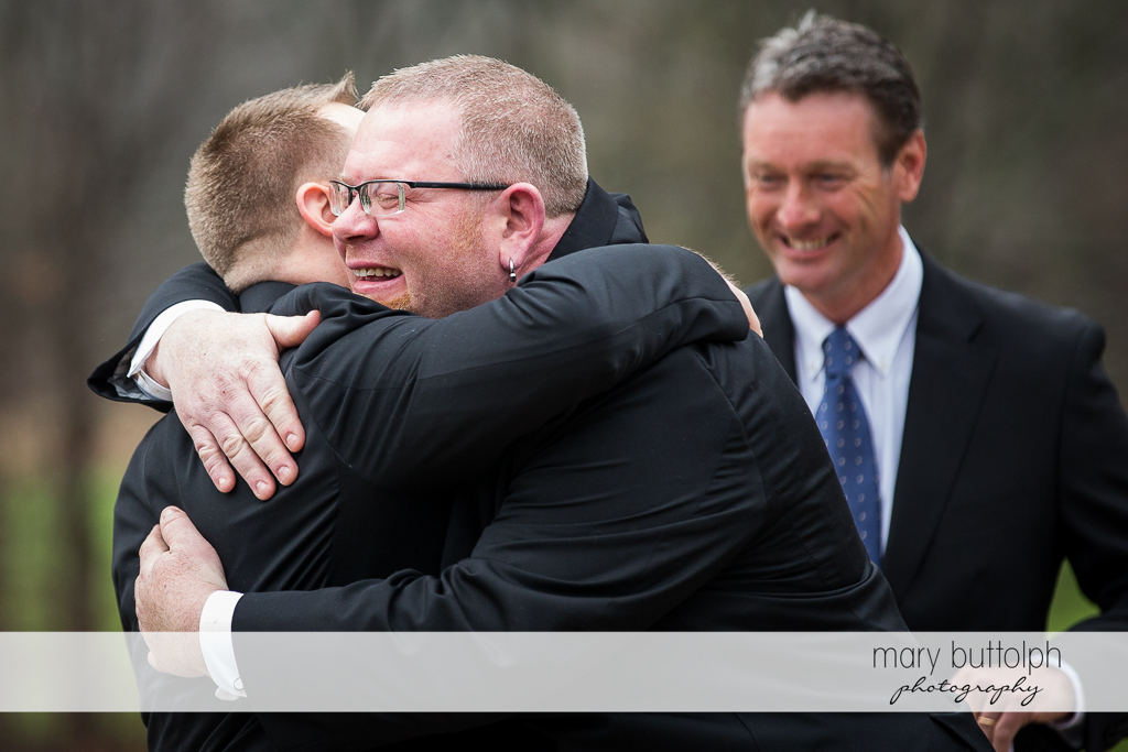 Same sex couple embrace after the wedding at Arrowhead Lodge Wedding