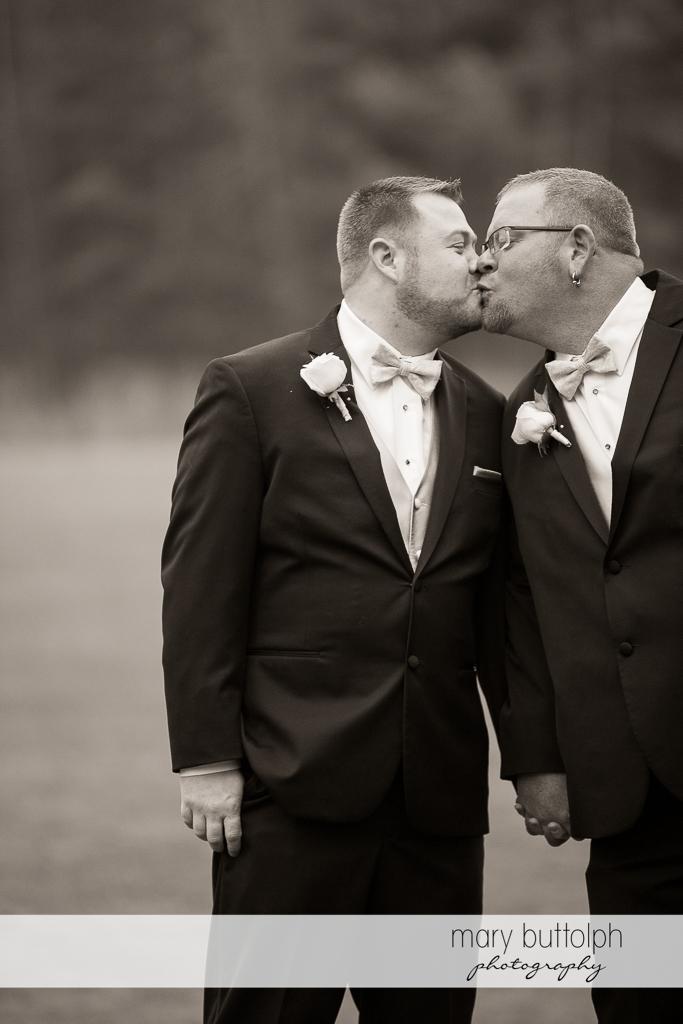 Same sex couple kiss at Arrowhead Lodge Wedding