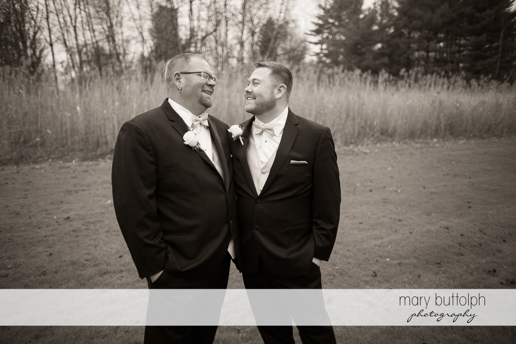 Same sex couple pose in the woods at SArrowhead Lodge Wedding