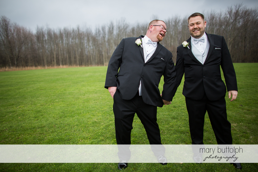 Same sex couple having a great time in the woods at Arrowhead Lodge Wedding