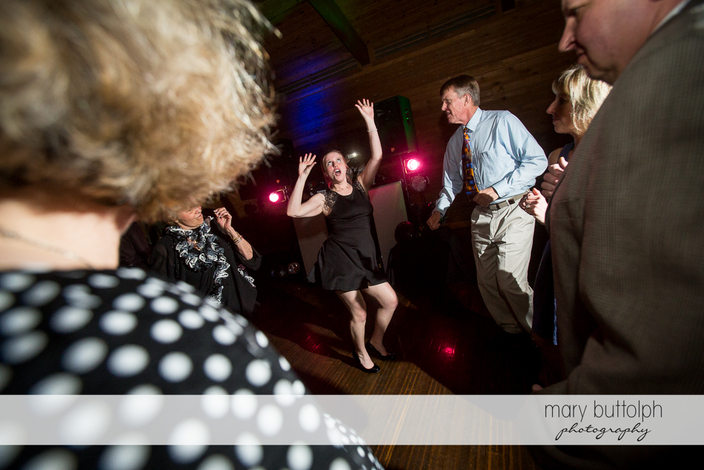 Female guest shows her dance moves at the wedding venue at Arrowhead Lodge Wedding