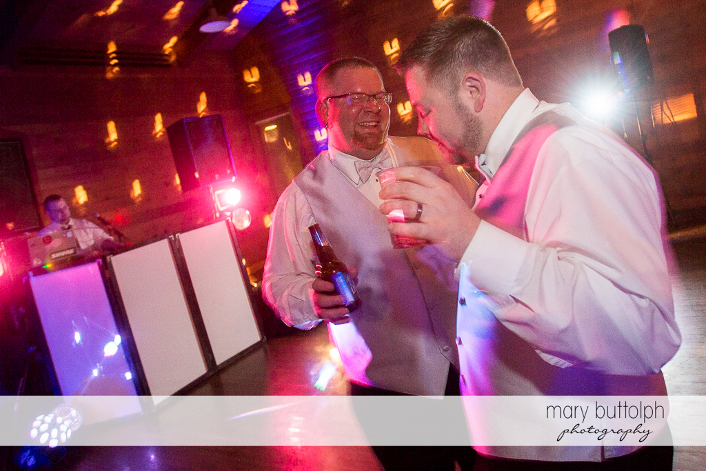 Same sex couple drink and dance at Arrowhead Lodge Wedding