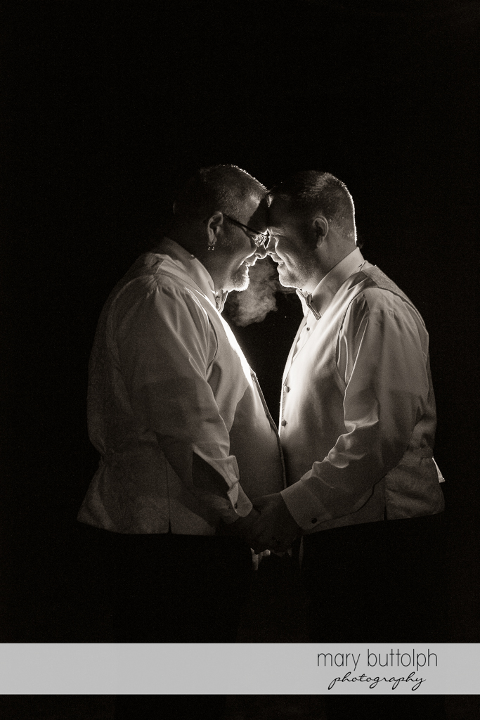 Same sex couple hold hands in the moonlight at Arrowhead Lodge Wedding