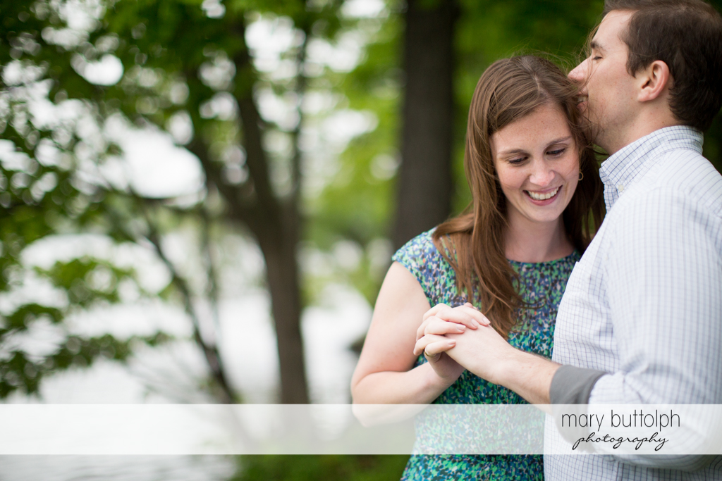 Couple pose near trees by the lake at the Hamilton Inn Engagement