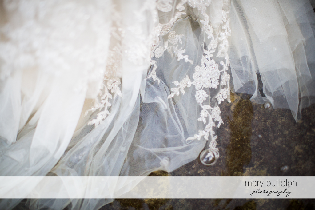 Detail of the bride's wedding gown at Taughannock Falls Wedding