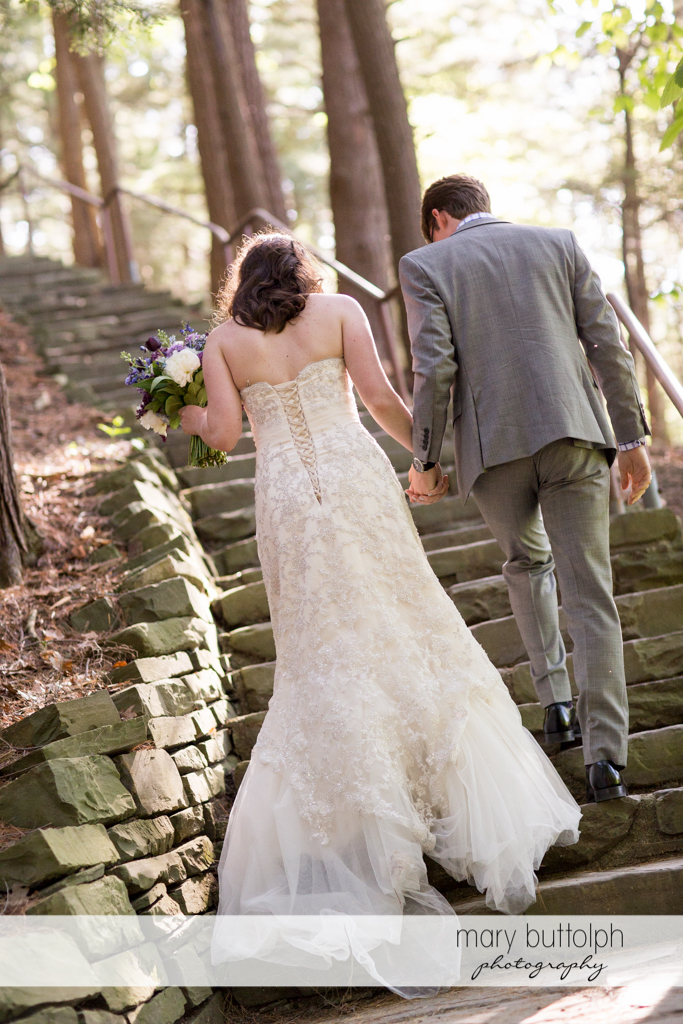 Couple climb the stone steps at Taughannock Falls Wedding