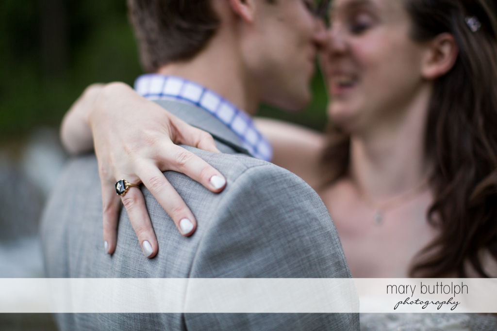 Bride's wedding ring is visible as she embraces the groom at Taughannock Falls Wedding