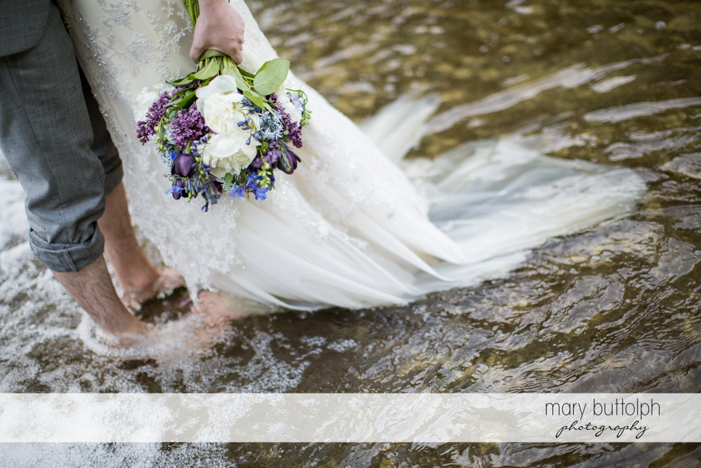 Couple don't mind if their wedding clothes get wet at Taughannock Falls Wedding