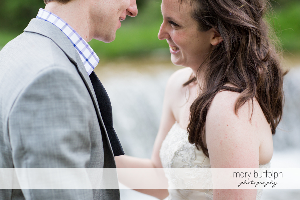 Happy couple share a quiet moment at Taughannock Falls Wedding